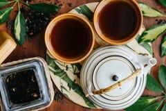 Black brew tea. In cups Stock Image