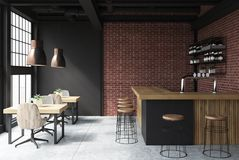 Black and brick bar interior. Brick and black loft bar interior with a concrete floor, a bar with stools and wooden tables with chairs. 3d rendering mock up Stock Photography