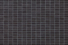 Black brick tile wall. Background seamless and texture Stock Photography