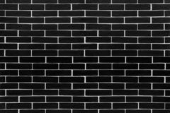 Black brick tiles with white contrasting grouting stock photos