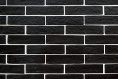 Black brick tiles with white grouting. Textures stock images