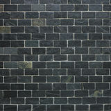 Black brick wall background. Wall built from black bricks Stock Photography