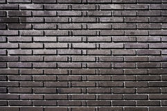 Black brick wall background texture. Close up Royalty Free Stock Images