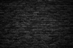 Black brick wall, dark background for design. Gloomy background, black brick wall of dark stone texture Stock Photos