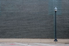 Black Brick Wall With Light Post. And copy space Stock Photos