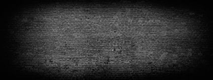 Black brick wall panoramic background. Black brick wall background. Wide high resolution panorama of brickwork