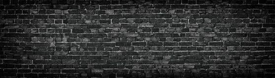 Black brick wall, texture of dark brickwork close-up royalty free stock photos