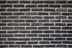 Black brick wall, texture background Stock Images