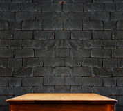 Black brick wall and wooden table,perspective background Royalty Free Stock Photography