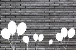 Black bricks with balloons Stock Photography