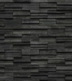 Black bricks slate texture background, slate stone wall texture Royalty Free Stock Images