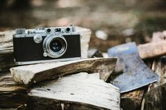 Black Bridge Camera on Wood Burner Beside Pickaxe Royalty Free Stock Photography