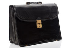 Black briefcase. Worn black briefcase,  on white with reflection on bottom Royalty Free Stock Image