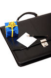 Black briefcase and blue gift Royalty Free Stock Photos