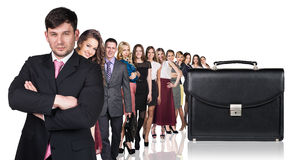 Black briefcase foreground and business peole Stock Photos