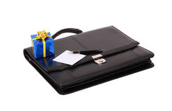 Black briefcase and gift Stock Photography