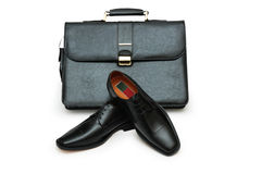 Black briefcase and male shoes isolated Royalty Free Stock Images