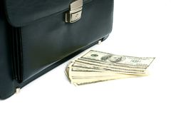 Black briefcase and money Royalty Free Stock Images