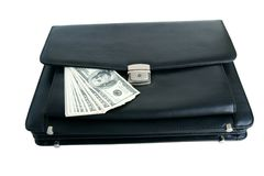 Black briefcase and money Royalty Free Stock Image