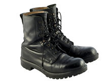 Black British Army Issue Combat Boots. A pair of worn black, leather british army issue combat boots Stock Images