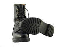 Black British Army Issue Combat Boots. A pair of worn black, leather british army issue combat boots royalty free stock images