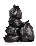 Black british bags. Stacked black british garbage bags isolated on white background stock photography