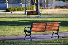 Black and Brown Bench Near Grass Field Stock Photography