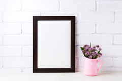 Black brown  frame mockup with purple flowers in polka dot pink Royalty Free Stock Images