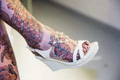 Black and Brown Henna Drawings on Woman Leg and Feet for African stock photos