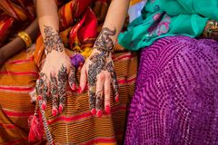Black and Brown Henna Hands Drawings on Women for African Wedding Ceremony. royalty free stock photography