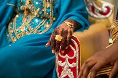 Black and Brown Henna Hands Drawings on Women for African Wedding Ceremony with Gold Ring. royalty free stock image