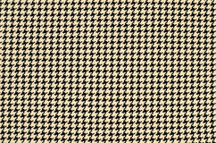 Black and brown houndstooth pattern. Stock Image