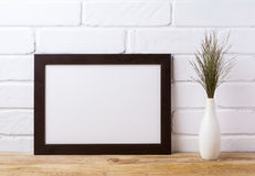 Black brown landscape frame mockup with dark grass in elegant v stock images