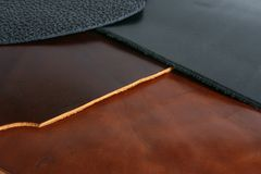 Black and brown leathers. Natural black and brown leathers background closeup Royalty Free Stock Image