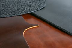 Black and brown leathers. Natural black and brown leathers background closeup Royalty Free Stock Photo