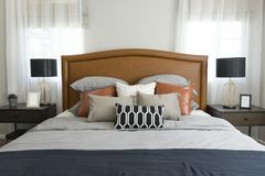 Pillows setting on bed with brown leather headboard Royalty Free Stock Image