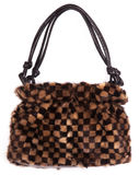 Checkered purse. Black and brown checkered purse made of fur Royalty Free Stock Photography