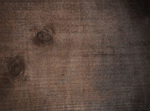 Black, brown scratched grunge wooden cutting board. Wood texture. Stock Photos