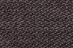 Black and brown vintage fabric with woven texture closeup. Textile macro background Royalty Free Stock Photography