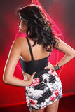 Black brunette on red Royalty Free Stock Photo