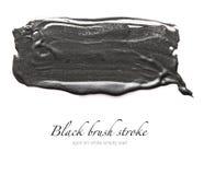 Black brush stroke on white empty wall Stock Photography