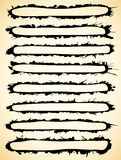Black brush strokes made of ink splatter. Royalty Free Stock Photos