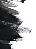 Black brush strokes on white paper Stock Photo