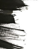 Black brush strokes on white paper Royalty Free Stock Photos