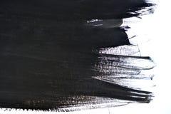 Black brush strokes on white paper Royalty Free Stock Image