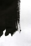 Black brush strokes on white paper with one hand isolated Royalty Free Stock Photo