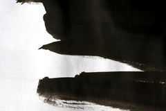 Black brush strokes on white paper with one hand isolated Royalty Free Stock Photography