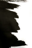 Black brush strokes on white paper with one hand isolated Stock Photography