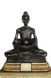 Black Buddha statue posture skinny. On white background Stock Images