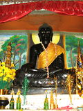 Black Buddha in Vang Viang, Laos. Buddhism Vang Viang Vieng religion Wat temple  Laos adornment faith white eyes Royalty Free Stock Photos